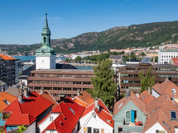 "The view looking toward the east from the Nordnes neighborhood atop the peninsula on the west side of the inner harbor (Vågen Harbor) of Bergen, Norway; the steeple, dated ""Anno 1761"