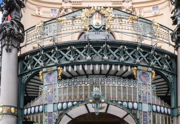 The wrought iron and stained-glass canopy entrance to the art-nouveau Municipal House, Prague, Czech Republic