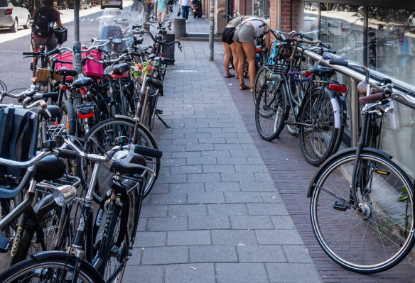While in most cities sidewalks are for pedestrian passage, in Amsterdam, many sidewalks serve as parking spots for bicycles; the city has more bikes than inhabitants and some 12,000 bicy