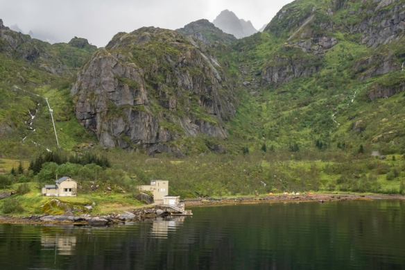 A close-up of the couple of building at the end of the fjord in Trollfjorden (Troll Fjord), Norway