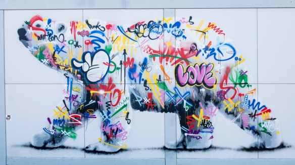 A graffiti polar bear decorates the outside wall of one of the shops in Longyearbyen, Spitsbergen Island, Svalbard