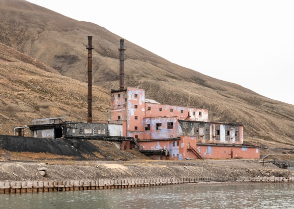 An abandoned factory building adjacent to the harbor at Pyramiden, Spitsbergen Island, Svalbard