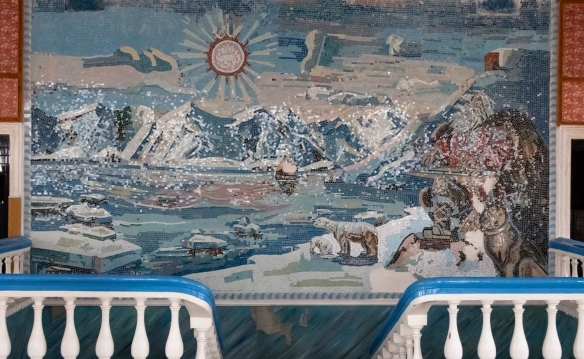 At the top of the dual staircase in the cantina is an elaborate, hand-made mosaic panorama of the Pyramiden site with the mountains and town overlooked by a female polar bear and her cub