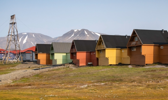 Brighly painted homes on the hill just above the central business district in Longyearbyen, Spitsbergen Island, Svalbard; presently there is a severe housing shortage in town (rentals an