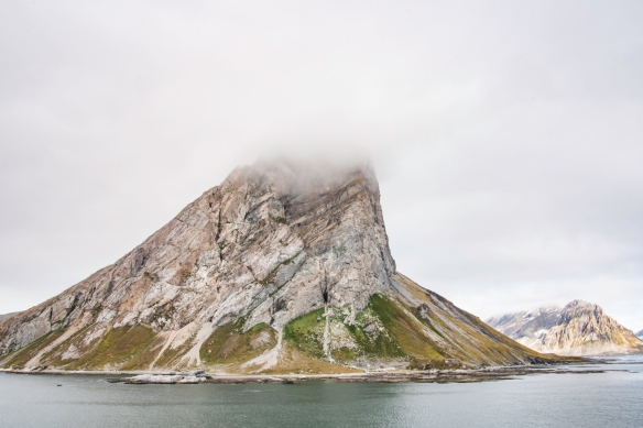 Gnålodden, Hornsund Fjord, Spitsbergen Island, Svalbard, photograph #2 -- the tall, narrow rocky cliff at Gnålodden reminded us of the similar imposing cliff at Alkhornet at the entr