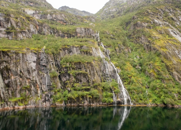 In addition to the larger, permanent waterfalls, many spontaneous waterfalls resulting from the rains appeared as we sailed through Trollfjorden (Troll Fjord), Norway_
