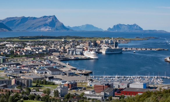 Our ship, the one on the right, is dwarfed by the rugged peaks on the islands surrounding Bodø, Norway