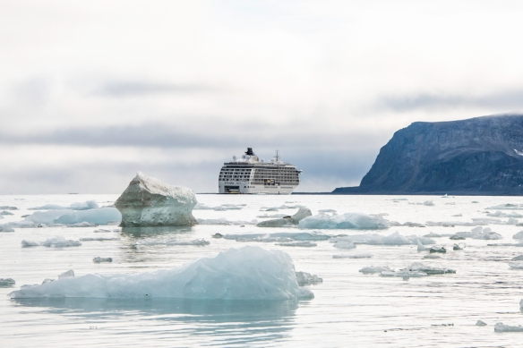 Raudfjorden (The Red Fjord), Spitsbergen Island, Svalbard, photograph #15 – our ship at anchor behind the icebergs in the middle of the fjord