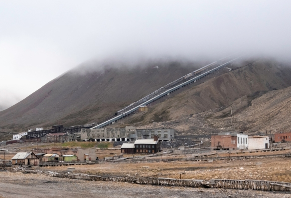 Shutes running down the mountainside from the mine (at 500 meters (1,640 -feet) elevation) to protect the buckets of coal that were gravity fed to the processing plant in Pyramiden, Spit