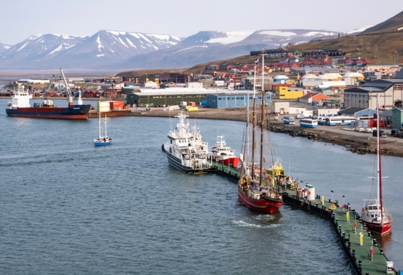 The harbor and pier of Longyearbyen, Svalbard, a small coal-mining town in the center of Spitsbergen Island – on the Adventfjorden (Advent Fjord), off Isfjorden -- located at latitude