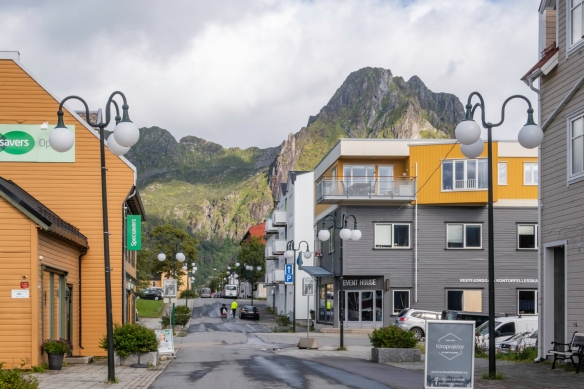 The main shopping street in Svolvaer, Norway, leads up to the spectacularly rugged mountains surrounding the town and harbor