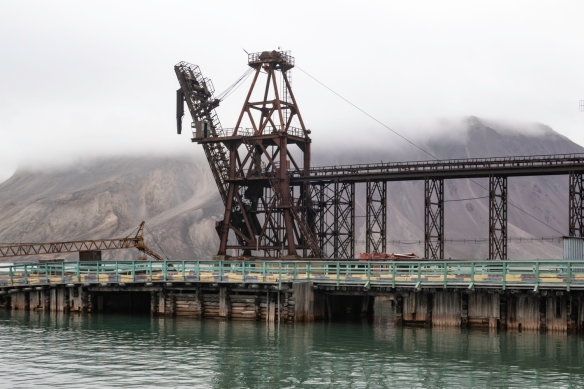 The pier at the harbor at Pyramiden, Spitsbergen Island, Svalbard, with a crane that helped load the locally mined coal onto transport boats for the journey back to the motherland (Russi