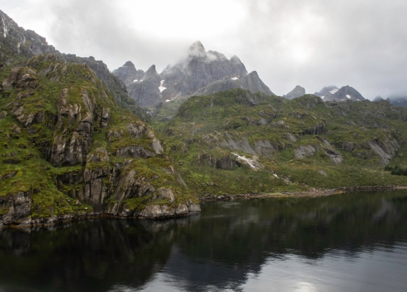 The steep mountains present a fantastic backdrop for the narrow waters of the fjord at Trollfjorden (Troll Fjord), Norway_