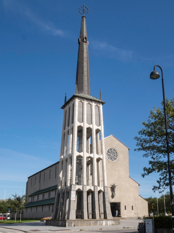 The striking, austere structure of Bodø Domkirke (Bodø Cathedral), completed in 1956, has a freestanding tower and spire, dedicated to those from the city who died during World War II