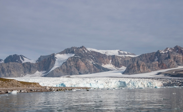 The tidewater glacier flowing into the fjord at Juli Bukta, Lilliehöökfjorden, Spitsbergen, Svalbard, as viewed from the water (from a Zodiac)