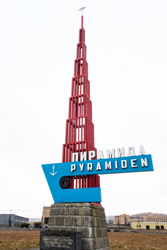 "The welcoming ""pyramid"" (in English and Russian) greeting visitors to the abandoned ""ghost town"" of Pyramiden, Spitsbergen Island, Svalbard, that was home to up to 1,500 people i"