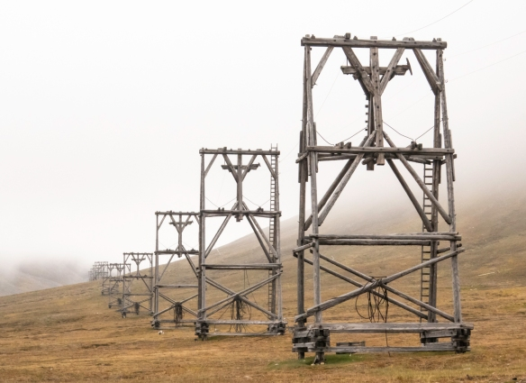 These wooden structures supported cables strung from the coal mine to the coal processing plant; buckets containing coal were lowered by gravity from the mine to the now closed plant; Lo