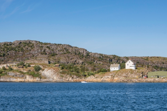 What appears to be an old fortification (left) on Lille Hjertøa island and two 19th century farm buildings, Bodø, Norway