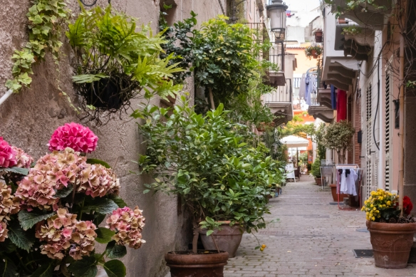 A side street in the main part of Lipari, Italy, with both residences and shops at the far end