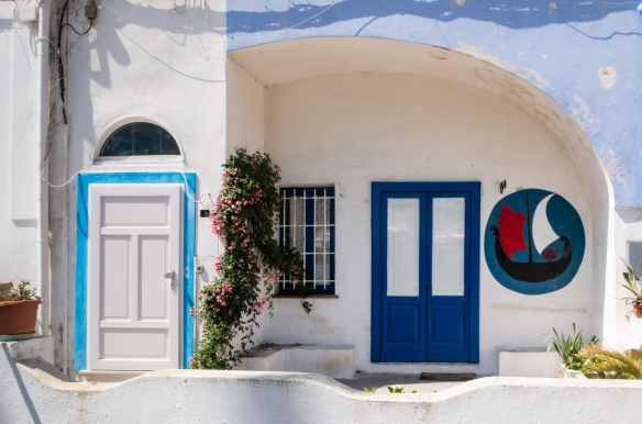 A typical home in Ponza, Italy, painted in Mediterrean blue shades