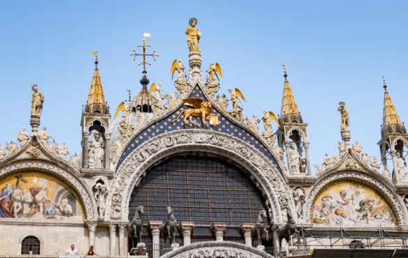 Basilica di San Marco (St. Mark_s Basilica) celebrates Byzantine architecture, featuring marble floors, gold mosaics, elaborate sculptures, red porphyry stone, and the Pala d_Oro alt