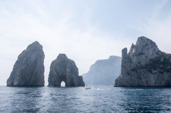 Capri (Island), Italy, #2 -- the famous arch just offshore Capri, with the island still partially shrouded in fog, mid-afternoon