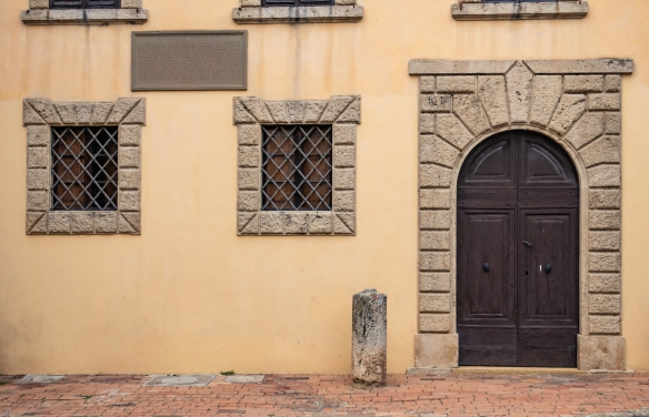 Classic Italian architecture in this façade in the town of Bolgheri, Italy_