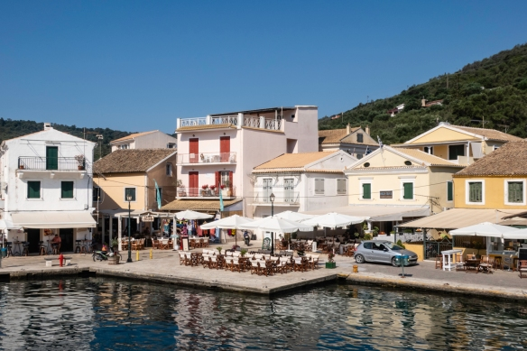 Gaïos on the small island of Paxos, Greece, is surrounded by turquoise waters and back-dropped by thriving olive groves and ife centers around the busy waterfront