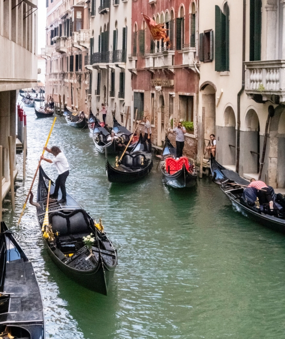 "Just off the Canale Grande (Grand Canal) is this ""parking"" area for the gondolas that are awaiting their turn to queue for a fare, Venice, Italy"