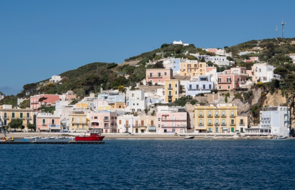 Pastel colored homes cling to the hillside in Ponza, Italy