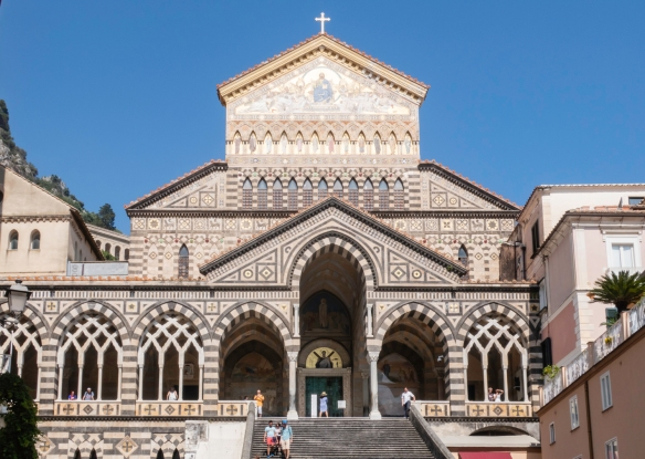 The façade of Cattedrale di Sant_Andrea (Cathedral of St. Andrew) is Byzantine in style and is adorned with various paintings of saints, including a large fresco of Saint Andrew, Ama