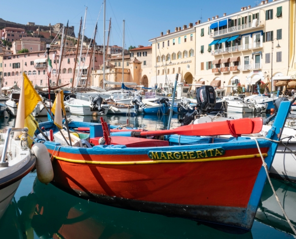 The main harbor of Portoferraio, Elba (island), Italy, is filled with brightly painted fishing boats