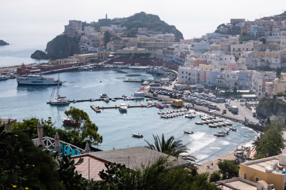 The picturesque and low-key island of Ponza, Italy, hosts Roman vacationers escaping the crowds; most arrive by boat in the harbor of the main town, also called Ponza