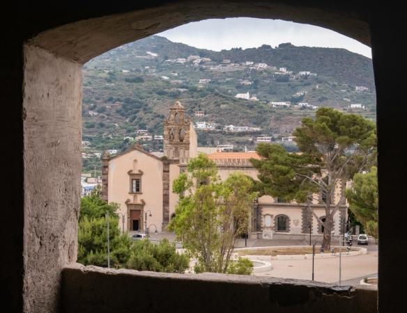 The view from an arched window in Castello di Lipari (Lipari Castle), Lipari, Italy