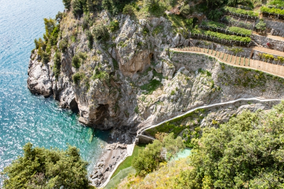The view looking down at the water and nearby wine vineyards from the terrace of Il San Pietro di Positano Hotel, Positano, Italy #4