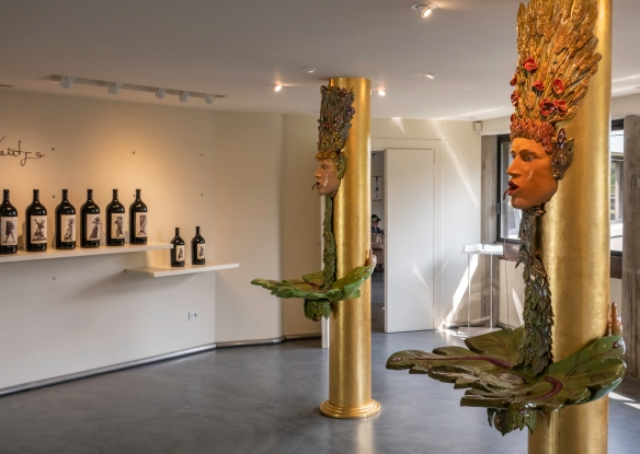 The visitor center at the front of the Ornellaia winery building in Bolgheri, Italy, features a display of artist-designed labels for Ornellaia vintages and a fabulous collection of mode