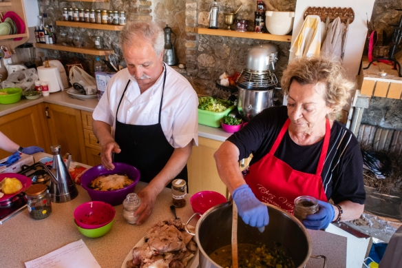 Vassiliki and George demonstrating the making of lamb meatballs and the egg-lemon sauce (Avgolemono sauce), Chez Vassiliki, Karavados, Kefalonia Island, Greece