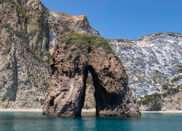 We motored past the small island of Gavi on the northern tip of Ponza, viewing the natural arch, said to grant a wish to those who pass beneath it, Ponza, Italy