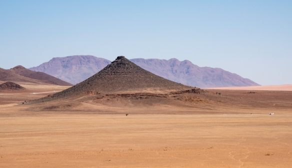 A close-up of the previous scene with the cone – note the airplane on the runway on the far right; &Beyond Sossusvlei Desert Lodge, Namibia