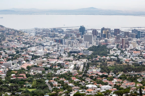 A view of the north waterfront of Cape Town, South Africa, from the lower cable car station at the base of Table Mountain; our ship is visible just to the right of the three blue roofs o