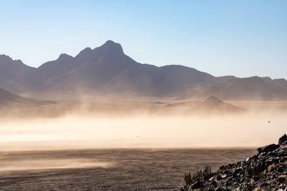 A view of the sandstorm from up on the mountainside, NamibRand Nature Reserve, Namibia