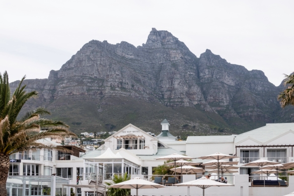 """Apartments and The Bay Hotel in very popular Camps Bay, tucked under the western side of Table Mountain [the view of the """"flat top"""" of Table Mountain is from the north], Cape Town, S"""