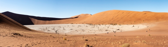 Deadvlei, Namibia, #1 – a panorama of the entirety of Deadvlei, with Big Daddy dune on the far left (in shadows) and lots of dead acacia trees visible in the white salt floor of the pa