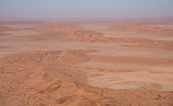 Our pilot flew away from the river bed for a better view of the rolling red sand dunes of the Namib Desert, Namibia
