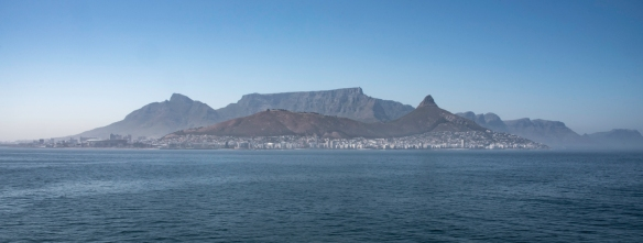 Table Mountain -- its near vertical cliffs and flat-topped summit are over 1,000 meters (3,300 feet) high -- with Devil_s Peak and Lion_s Head on either side, Cape Town, South Africa