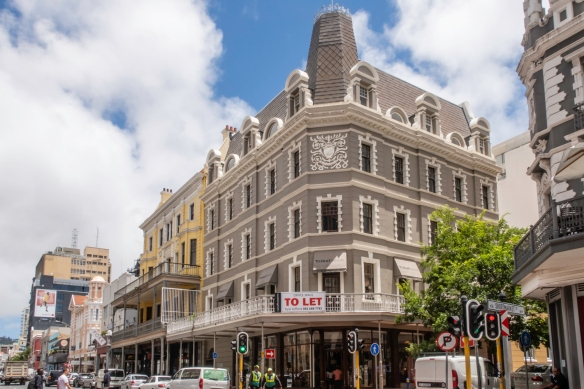 The Central District of Cape Town, South Africa, contains buildings from multiple generations of business people, nicely interspersed, avoiding the monotony of all glass skyscrapers foun