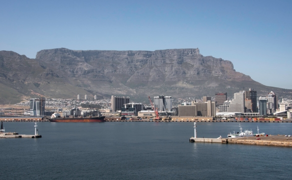 The dramatic entrance to the Cape Town Harbor, directly underneath Table Mountain, in front of downtown Cape Town, South Africa
