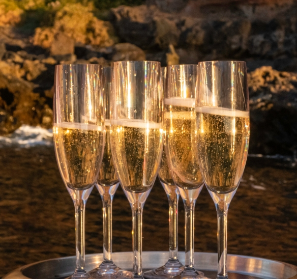 To celebrate our last night at Saint Helena Island, our expedition team organized a sunset Zodiac cruise and the beverage team visited each group on a Zodiac with glasses of Champagne to