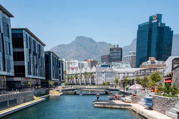 Water sports in the canal adjacent to the Silo District in the shadow of contemporary new office buildikngs, Cape Town, South Africa