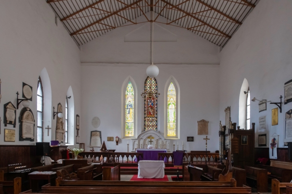 """The interior of St. James Church, Jamestown, Saint Helena Island; curiously the Hebrew name for God, """"Adonai"""", is inscribed just ablve the top of the gold cross on the altar"""